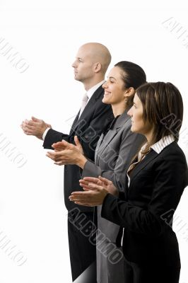 Businesspeople in a row clapping