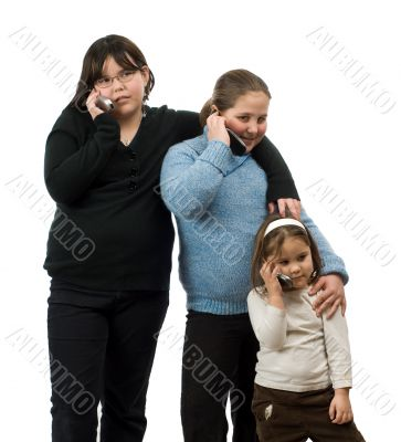 Three Girls Talking On Cell Phones