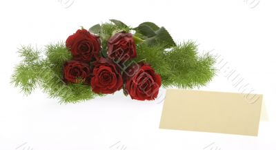 red roses with a cream-colored place card