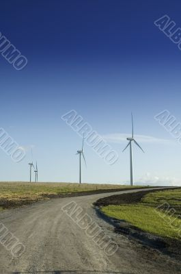 Wind generators at the end of a dirt road