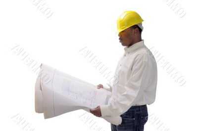 young African American contractor studying plans