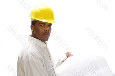 African American engineer studying house plans
