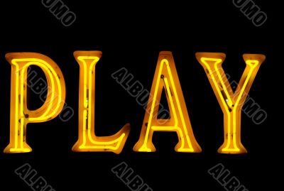 Neon sign with the word `Play` over black