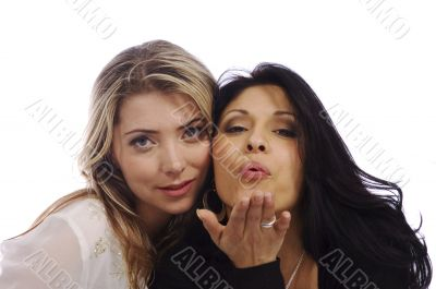 two sexy woman smiling and blowing a kiss