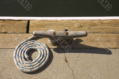 Rope coiled up attached to cleat