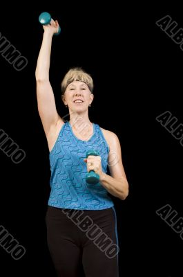 Attractive baby-boomer woman exercising