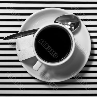 Coffee cup on the striped surface