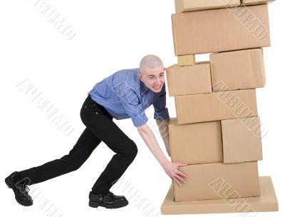 Man push pile cardboard boxes