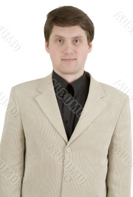 Portrait of young businessman in beige suit