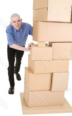 Man pushing heap from cardboard boxes