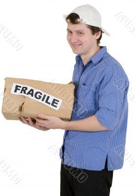 Man holded cardboard box with inscription `fragile`