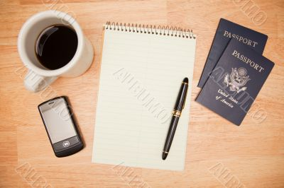 Overhead Pad, Pen, Passports, Coffee and Cell Phone