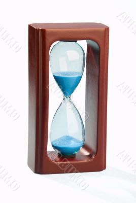 Mahogany sand timer isolated on white background