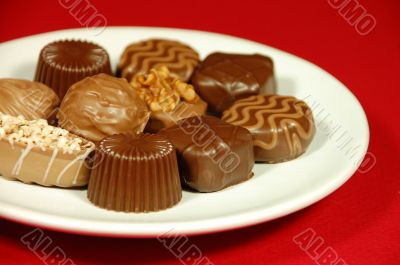 Chocolates on white plate
