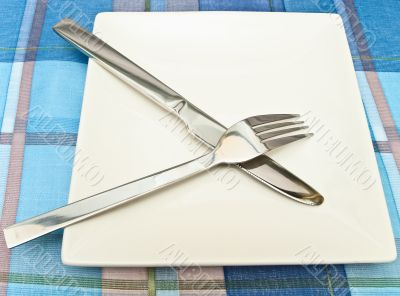 dish with fork and knife