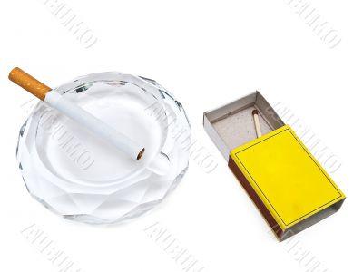 ashtray, cigarette and match