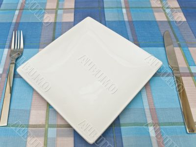 dish with fork and knife at tablecloth