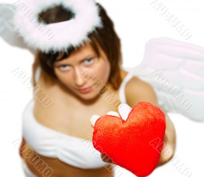 Young woman at angel`s costume with red heart
