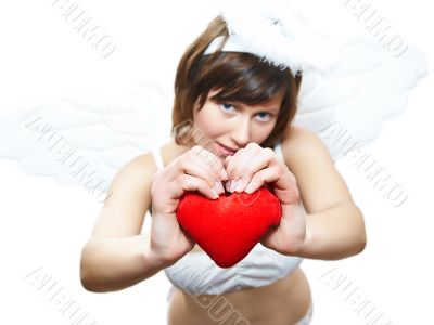 Young woman in angel`s costume with red heart