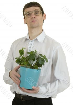 Man in spectacles with window plant in flowerpot