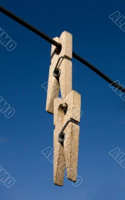 Two wooden clothes-peg
