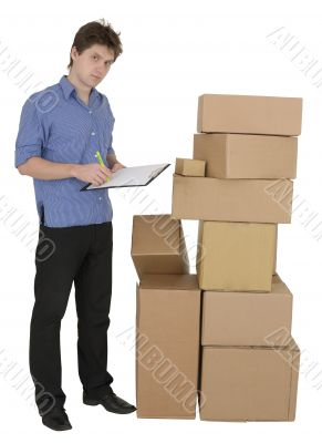 Man with marker and pile cardboard boxes