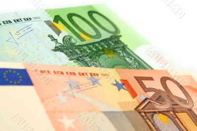 a few euro bills on a white background