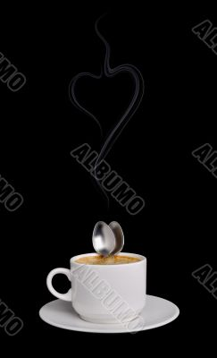 Two spoons embrace in a cup coffee
