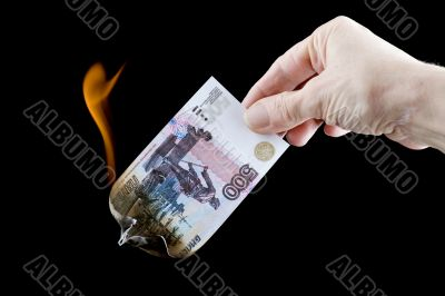 burning paper currency close up
