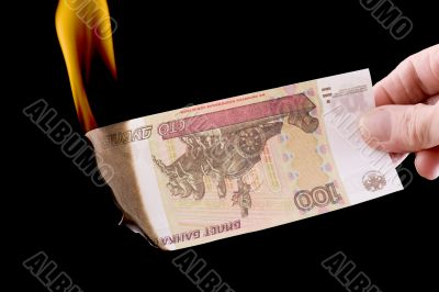 burning paper currency macro