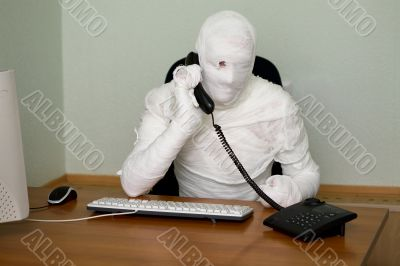 Businessman mummy with telephone