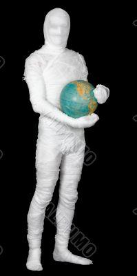 Man in costume mummy and terrestrial globe