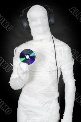 Man in bandage with ear-phones and disc