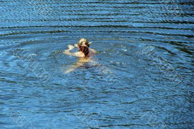 single female figure in wide water surface