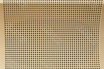 Metallic light golden perforated background