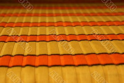 Yellow-orange horizontal striped cloth background