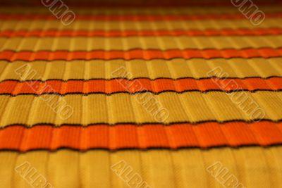 Yellow-orange horizontal striped cloth background