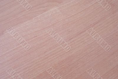 Light brown wooden background with diagonal veins