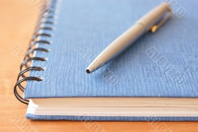 Writing materials on the light brown wooden table