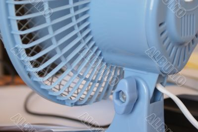Light blue ventilator on the desk