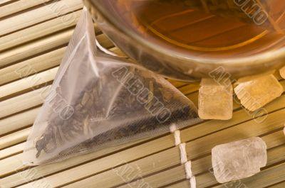 white tea, nylon tea-bag and sugar