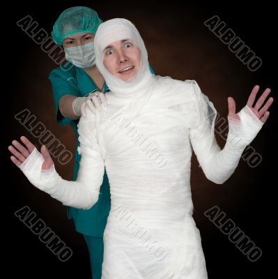 Man in bandage and nurse
