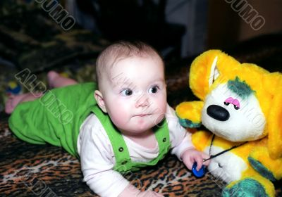 Infant with yellow chinchilla toy