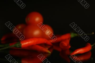 Red hot chilli pepper and tomato