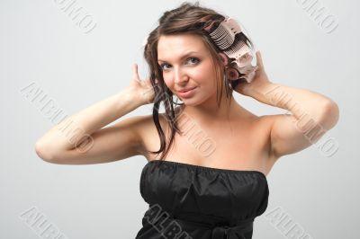 girl in hair curlers