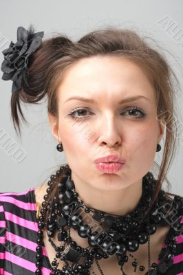 Kiss. Attractive young woman.