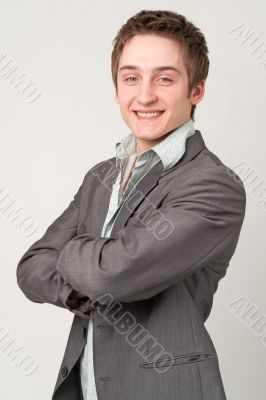 young businessman with arms across