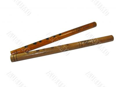 Two vintage wooden musical pipes isolated over white background