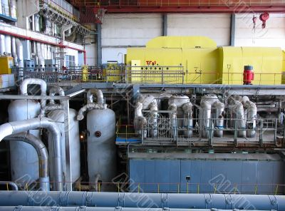 Steam turbine at a power plant with tubes and machinery