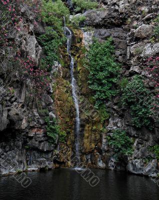 Waterfall on black basalt rocks